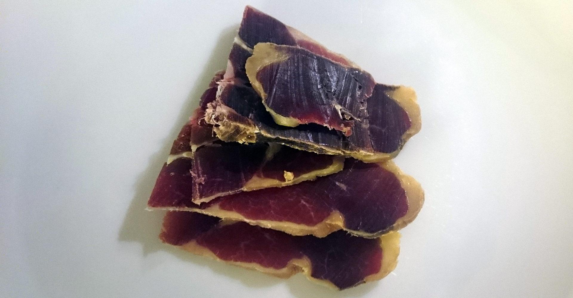 four slices of cured leg of lamb called fenalar in norwegian